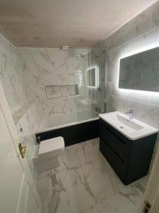 Marble tile bathroom, Menston with LED mirror