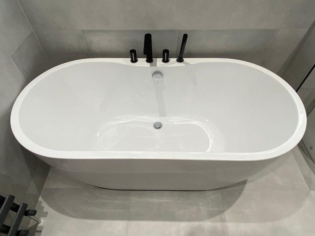Black, chrome and gold bathroom taps Otley